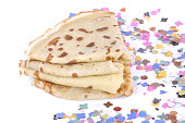 pile of french pancakes in confetti and on white background