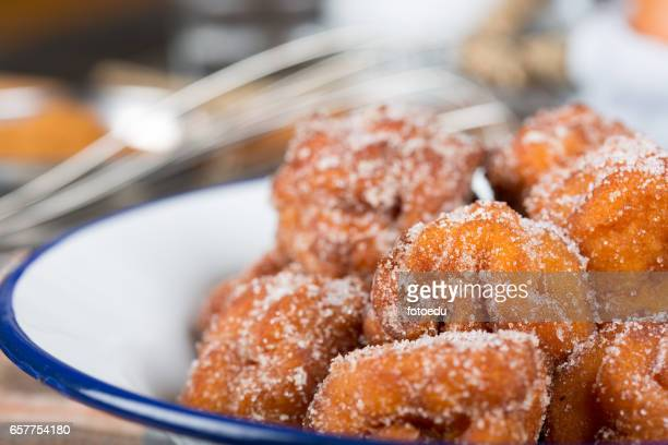 Homemade fritters with sugar