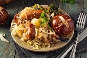 Homemade German Sausage and Sauerkraut with a Pretzel Roll