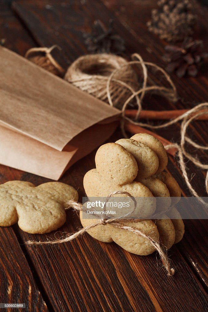 homemade gingerbread cookies on wooden background : Stock Photo