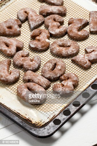 Homemade gingerbread figures with icing sugar : Stock Photo