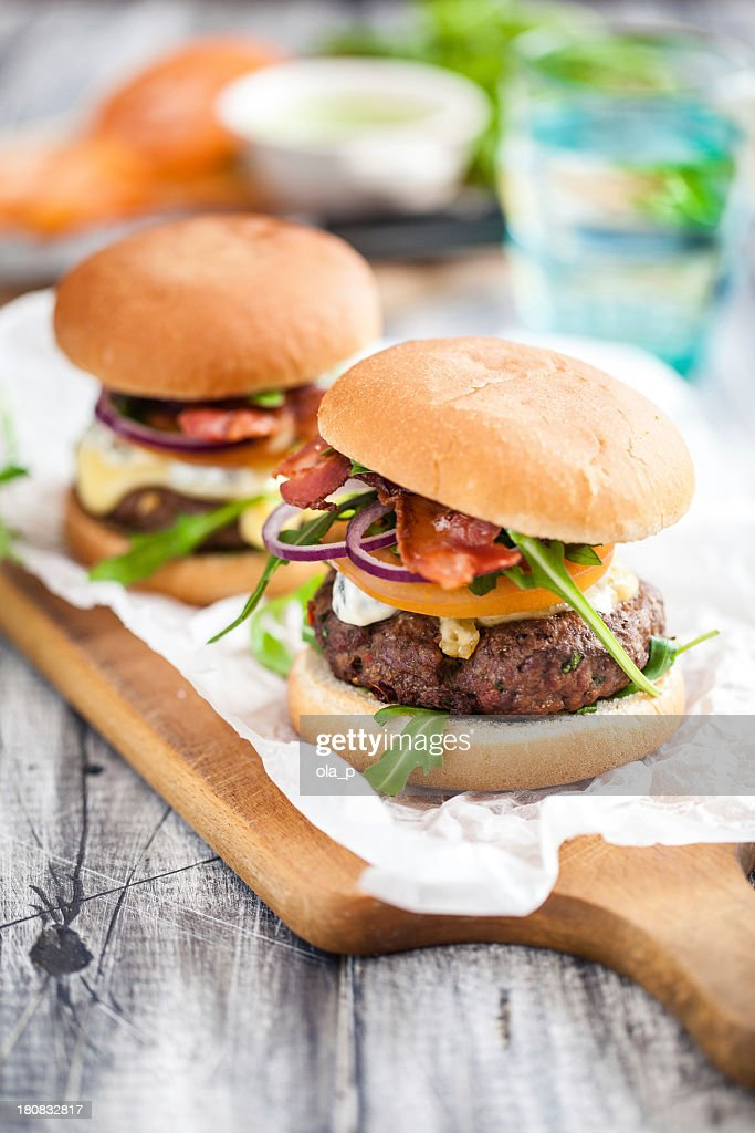 Homemade hamburgers served on a wooden paddle