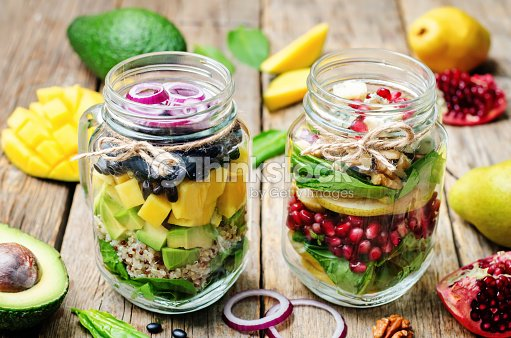 Homemade healthy salads with vegetables, fruits, beans and quinoa