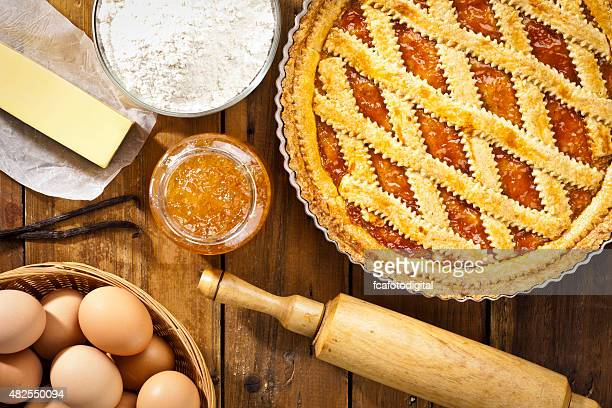 Homemade italian crostata with ingredients shot directly above