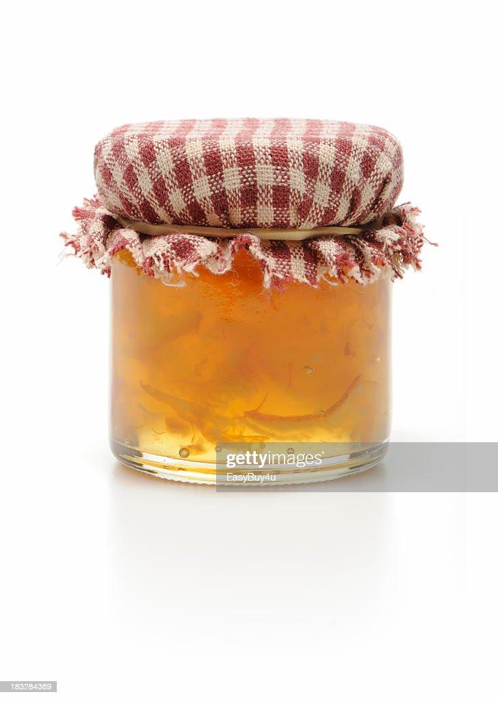 Homemade jar of marmalade isolated in white