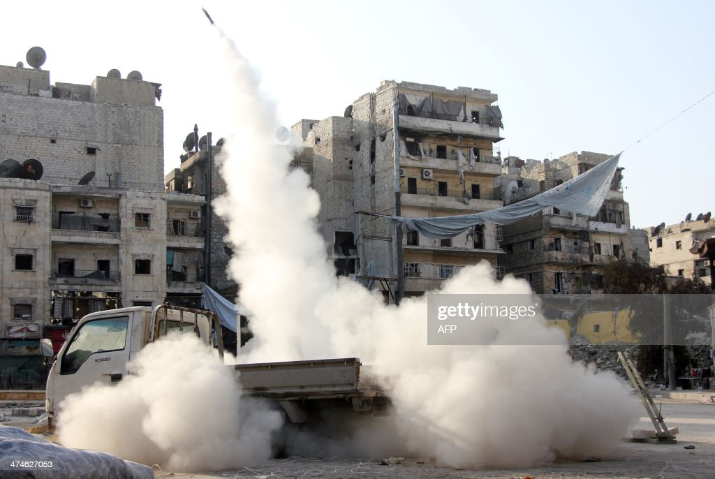 A homemade missile is launched towards the location of pro-regime fighters in the northern Syrian city of Aleppo on February 24, 2014. Syrian troops battled rebels over a strategic Aleppo district that could be key to securing a nearby prison and laying siege to the city's rebel-held east.