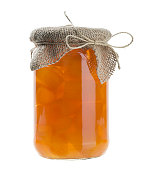 Orange jam in jar isolated on white.