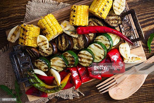 Homemade organic grilled summer vegetables on rustic table viewed from above