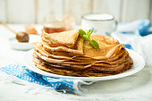 Traditional Russian pancakes served with honey and butter