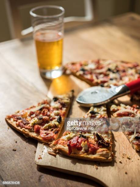 Homemade Pizza on wooden table with Beer