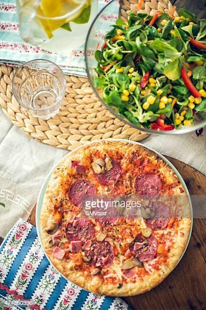 Homemade Pizza with Fresh Salad and Lemonade