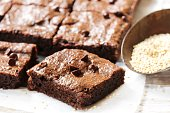Homemade Quinoa Brownies on white wooden background, selective focus