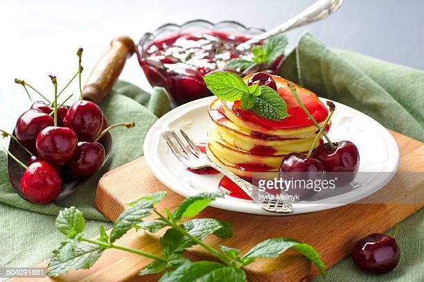 Homemade ricotta pancakes with cherry sauce