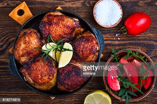Homemade roasted chicken thighs  in cast iron pan for dinner, top view : Stock Photo