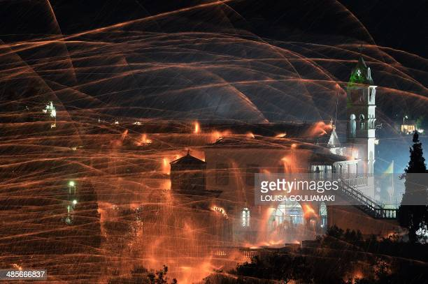 Homemade rockets streak through the sky targeting a church of Panagia Erithiani during a traditional Easter celebration in the village of Vrontados...