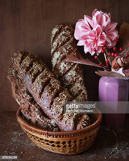 Homemade Rye Baguettes in Basket. Still Life