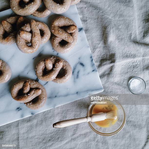 Homemade pretzels and bowl with egg yolk