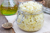 Homemade sauerkraut with cumin in a glass jar