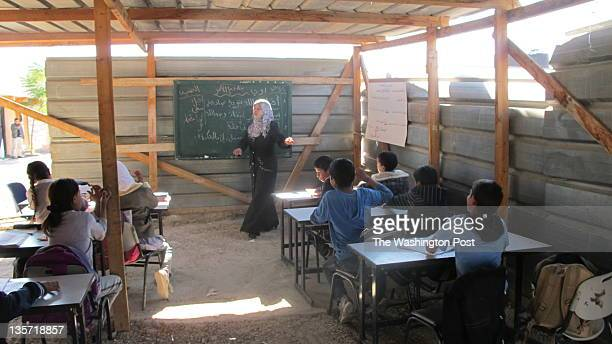 A homemade school built of rubber tires and mud at Khan alAhmar an encampent of Palestinian Bedouins from the Jahalin tribe who live off the main...