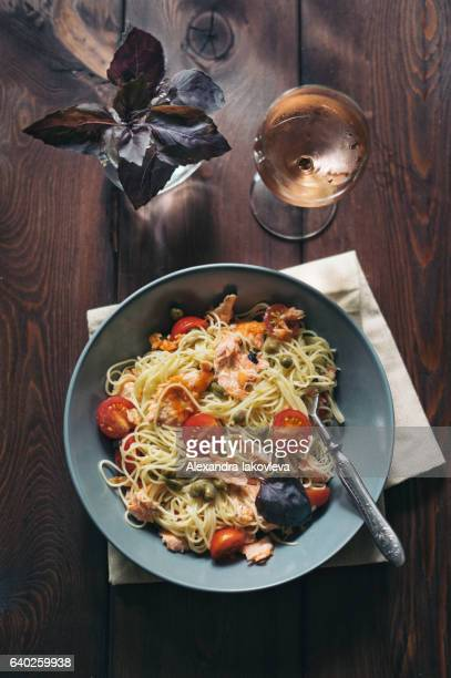 Homemade spaghetti pasta with salmon, tomatoes and capers