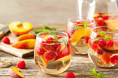 Homemade Sparkling White Wine Sangria with Peaches and Raspberries