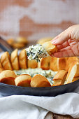 Great appetizer for party - spinach feta cheese dip with bread rolls.
