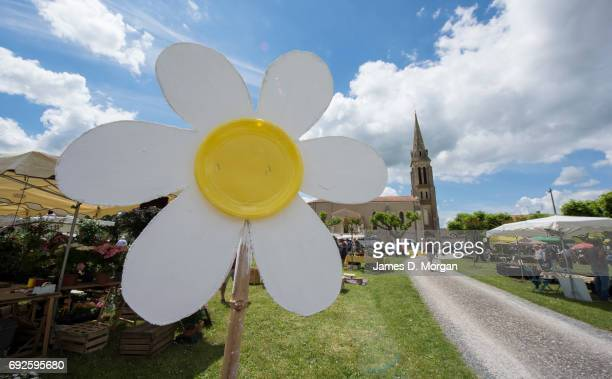 Homemade sunflowers made of cardboard and paper plates at a local fair on June 5 2017 in Saussignac France Monday is a public holiday in France...