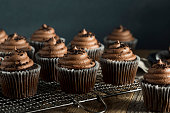 Homemade Sweet Chocolate Cupcakes with Dark Frosting on Top