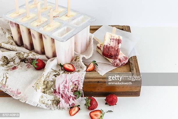 Homemade vanilla and rhubarb ice-cream popsicles