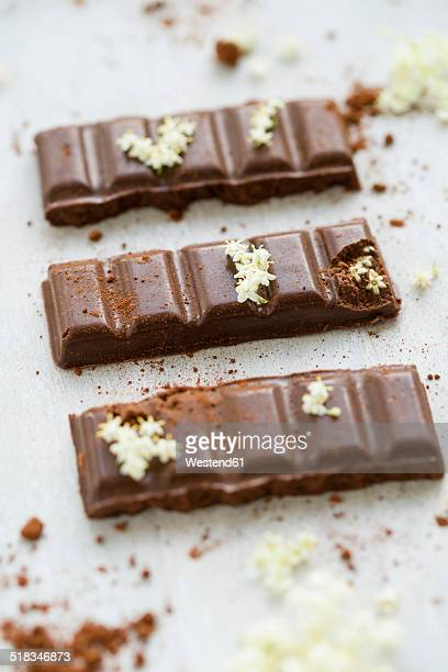 Homemade vegan chocolate with elderberry syrup and elderflowers