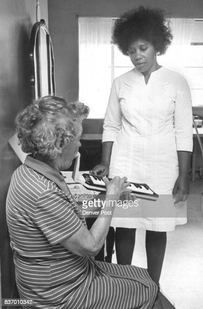 Homemaker Ada Busby operates record player as Mrs Georgia Caywood plays on her melodica Credit Denver Post