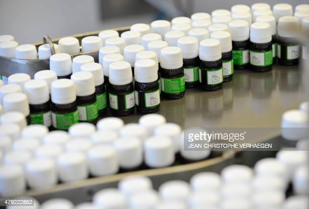 Homeopathic medicine bottles are pictured at the Lehning Laboratoires factory and headquarters in SainteBarbe eastern France on July 1 2015 Lehning...