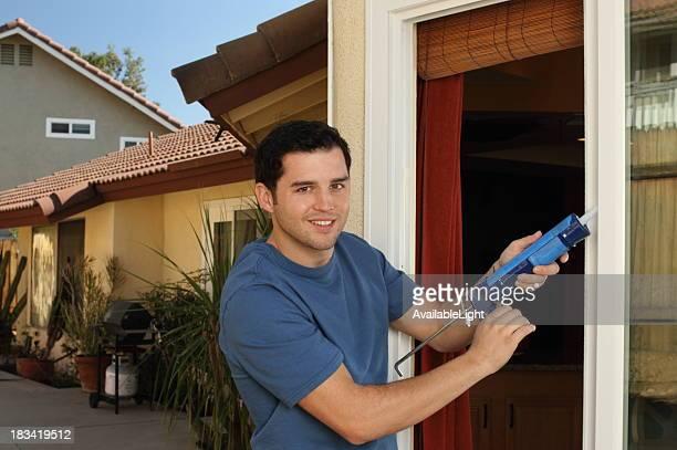 Homeowner Caulks Kitchen Window Horizontal