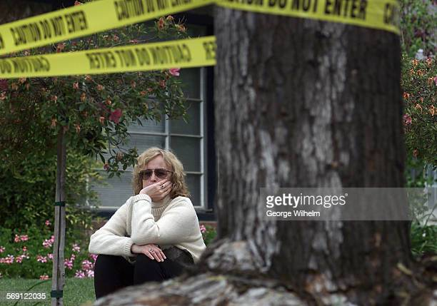 Homeowner Holly Ziman sits in her front yard in Northridge and waits for the crew from the county Vector Control District to solve a bee problem in a...