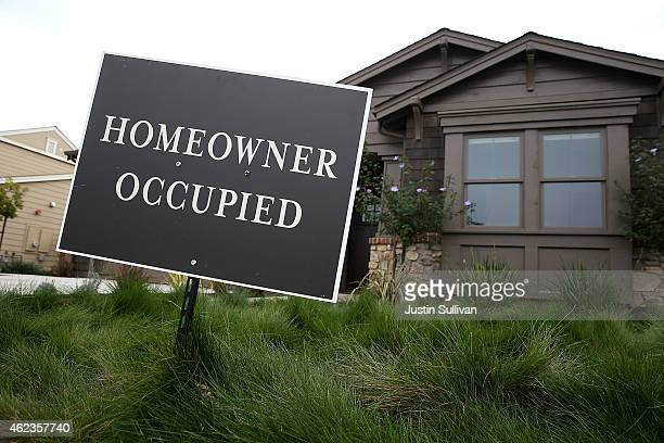 A homeowner occupied sign is posted in front of a recently purchased new home at the Rose Lane housing development on January 27 2015 in Larkspur...