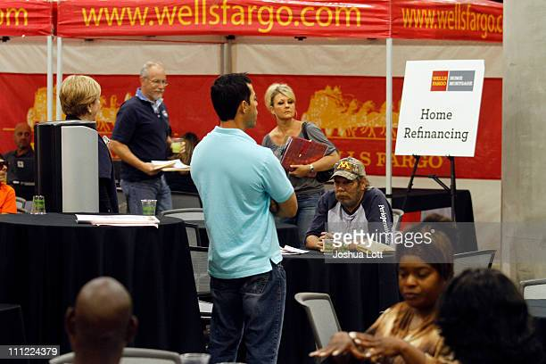 Homeowners wait to see a homepreservation specialist during a Wells Fargo homepreservation workshop at the Phoenix Convention Center March 30 2011 in...