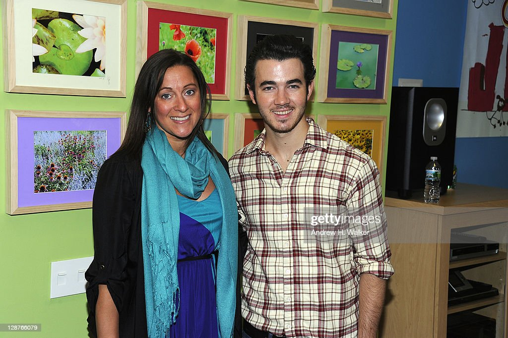 AOL Homepage Sales Executive Director Christa Zambardino and Kevin Jonas attend the unveiling of the AOL media room at the Roanld McDonald House on October 7, 2001 in New York City.