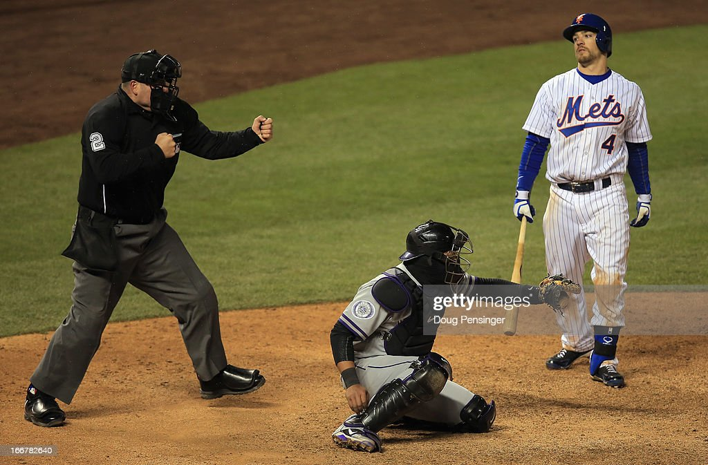 Homeplate umpire Dan Bellino calls <a gi-track='captionPersonalityLinkClicked' href=/galleries/search?phrase=Collin+Cowgill&family=editorial&specificpeople=6888953 ng-click='$event.stopPropagation()'>Collin Cowgill</a> #4 of the New York Mets out on strikes as catcher <a gi-track='captionPersonalityLinkClicked' href=/galleries/search?phrase=Yorvit+Torrealba&family=editorial&specificpeople=212721 ng-click='$event.stopPropagation()'>Yorvit Torrealba</a> #8 of the Colorado Rockies catches the pitch in the 10th inning at Coors Field on April 16, 2013 in Denver, Colorado. The Rockies defeated the Mets 9-8 in 10 innings.