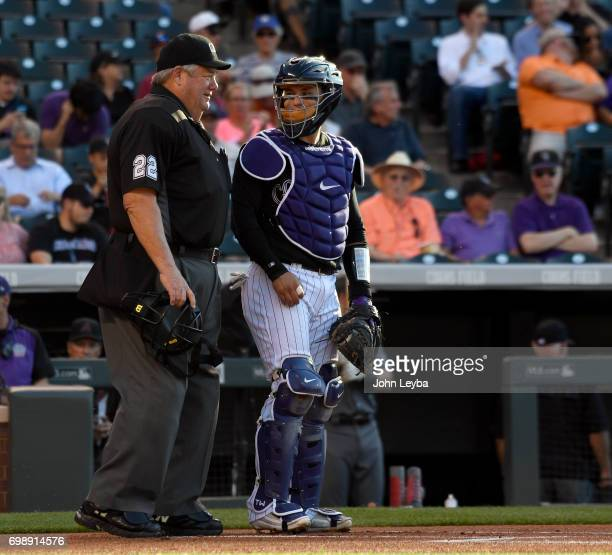 Homeplate umpire Joe West chats with Colorado Rockies catcher Tony Wolters at the start of their game against the Arizona Diamondbacks game on June...