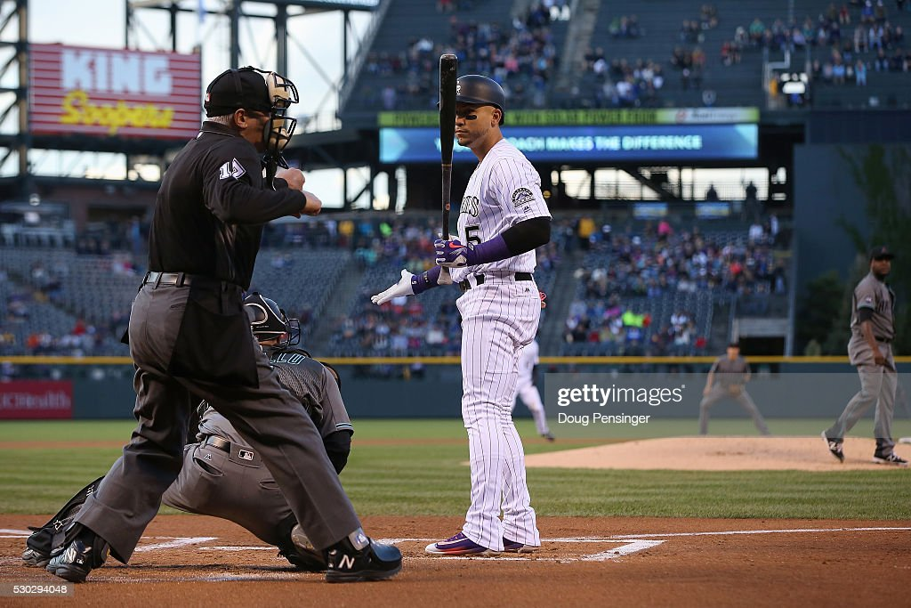 Homeplate umpire John Hirschbeck calls Carlos Gonzalez #5 of the Colorado Rockies out on strikes as he faces starting pitcher <a gi-track='captionPersonalityLinkClicked' href=/galleries/search?phrase=Rubby+De+La+Rosa&family=editorial&specificpeople=7521869 ng-click='$event.stopPropagation()'>Rubby De La Rosa</a> #12 of the Arizona Diamondbacks in the first inning at Coors Field on May 10, 2016 in Denver, Colorado.