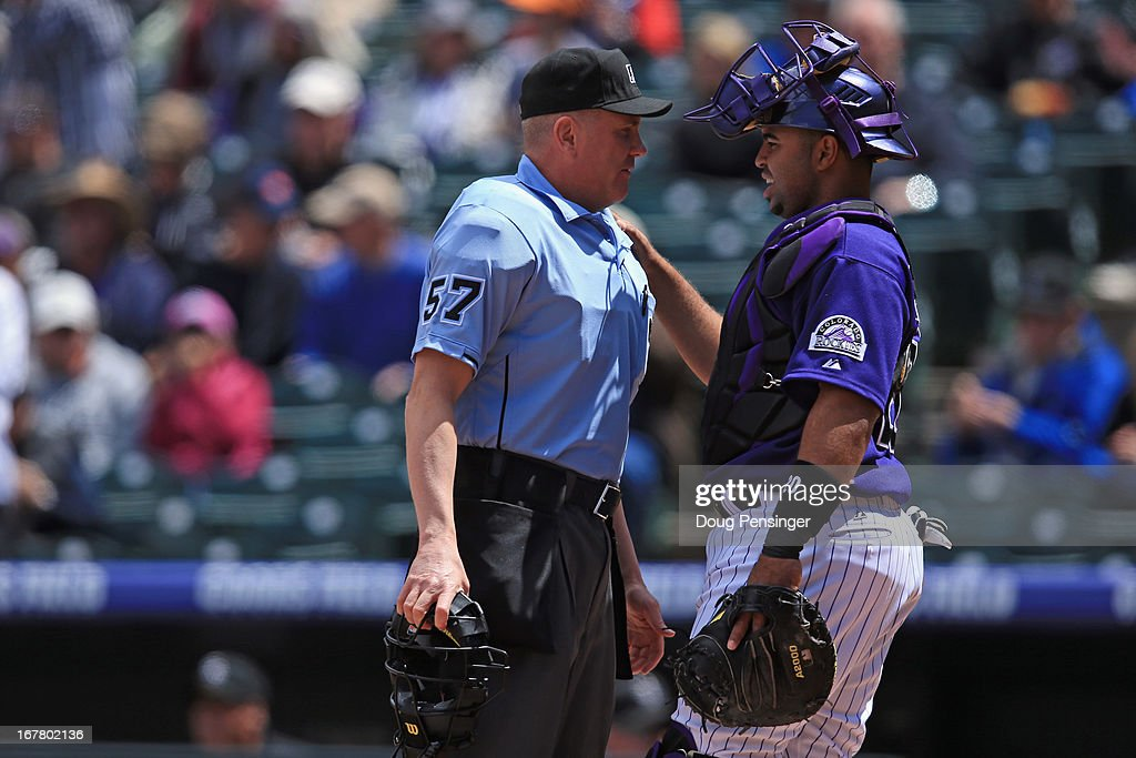 Homeplate umpire <a gi-track='captionPersonalityLinkClicked' href=/galleries/search?phrase=Mike+Everitt&family=editorial&specificpeople=238854 ng-click='$event.stopPropagation()'>Mike Everitt</a> and catcher <a gi-track='captionPersonalityLinkClicked' href=/galleries/search?phrase=Wilin+Rosario&family=editorial&specificpeople=5734314 ng-click='$event.stopPropagation()'>Wilin Rosario</a> #20 of the Colorado Rockies talk during the game against the Atlanta Braves at Coors Field on April 24, 2013 in Denver, Colorado. The Rockies defeated the Braves 6-5 in 12 innings.