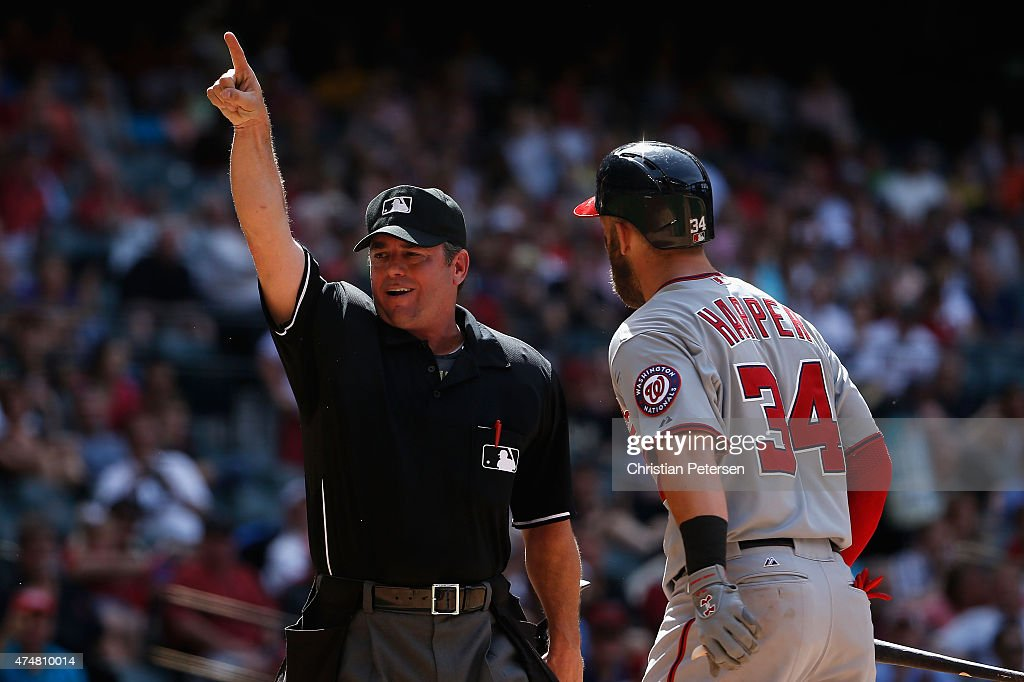 Homeplate umpire Rob Drake ejects Bryce Harper of the Washington Nationals for arguing a called third strike during the seventh inning of the MLB...