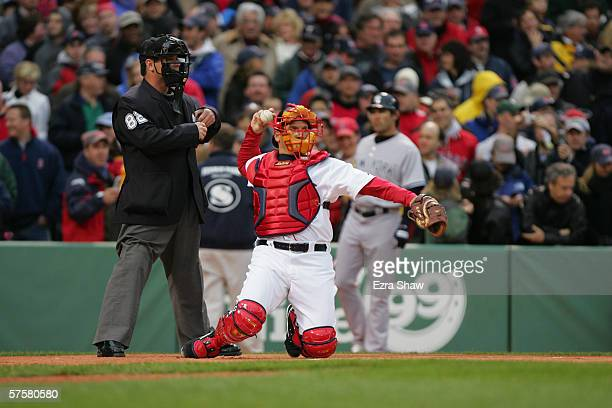 Homeplate umpire Rob Drake watches as catcher Doug Mirabelli of the Boston Red Sox returns the ball to the pitcher during the game against the New...