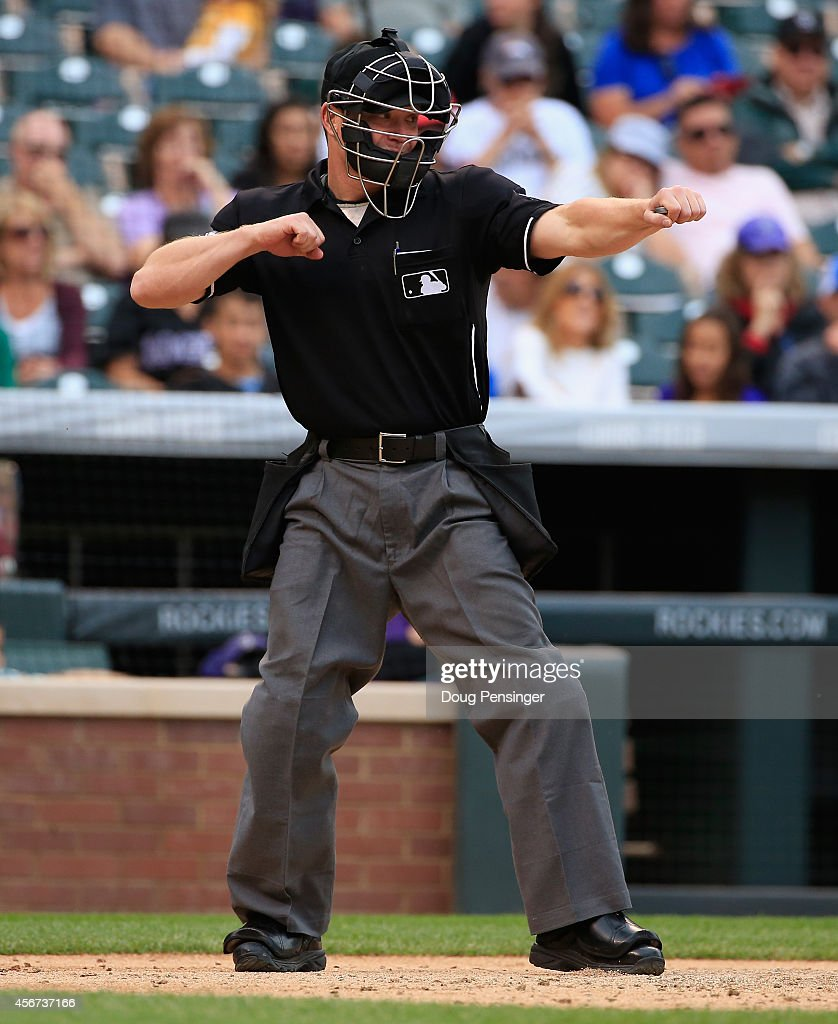 Homeplate umpire Toby Basner calls a player out on strikes as the Arizona Diamondbacks face the Colorado Rockies at Coors Field on September 21 2014...