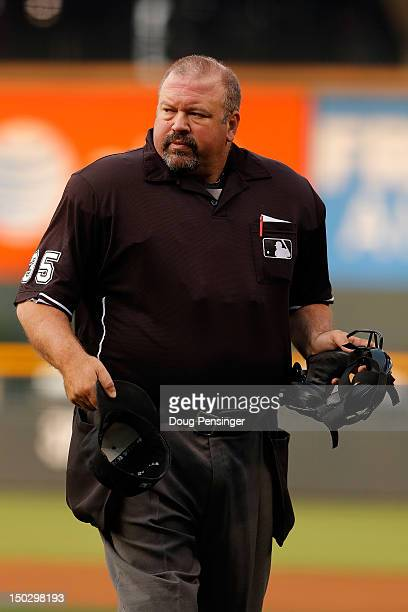 Homeplate umpire Wally Bell oversees the action between the Milwaukee Brewers and the Colorado Rockies at Coors Field on August 14 2012 in Denver...