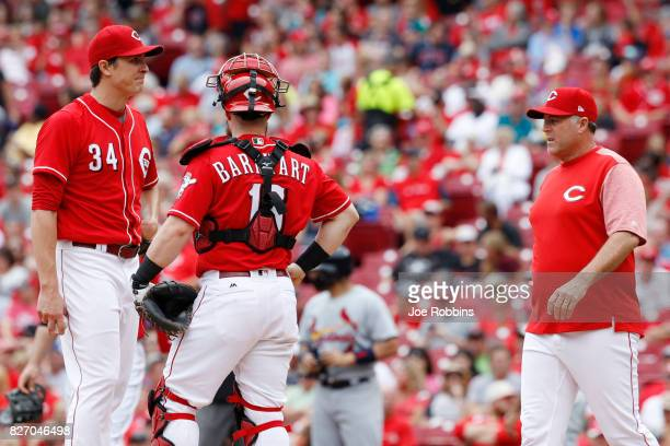 Homer Bailey of the Cincinnati Reds reacts as he is taken out of the game by manager Bryan Price in the fourth inning against the St Louis Cardinals...