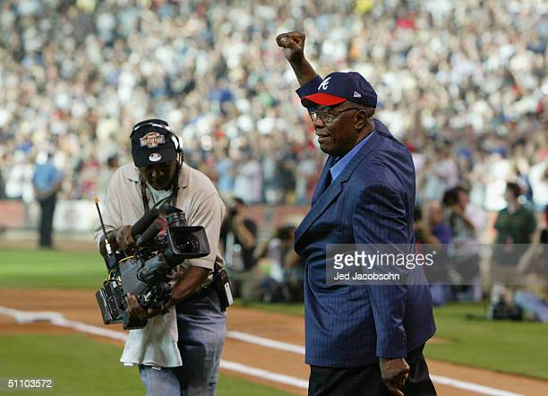 Homerun King Henry Hank Aaron walks out onto the field before the Major League Baseball Century 21 Home Run Derby at Minute Maid Park on July 12 2004...