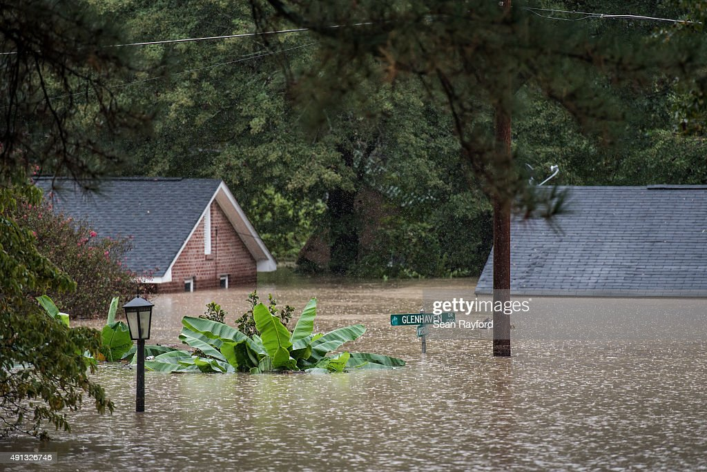 Homes are inundated by flood waters October 4 2015 in Columbia South Carolina The state of South Carolina experienced record rainfall amounts over...