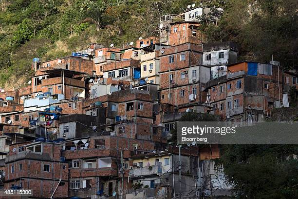 Homes are stacked on a hillside in the Rocinha favela in Rio de Janeiro Brazil on Thursday Aug 20 2015 With joblessness on the rise and abovetarget...