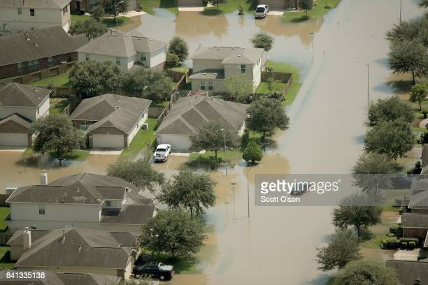 Homes are surrounded by floodwater after torrential rains pounded Southeast Texas following Hurricane and Tropical Storm Harvey on August 31 2017...